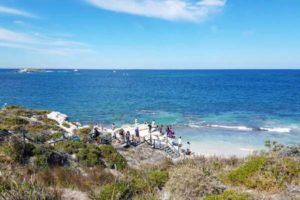 parker point rottnest island clear waters blue skies coastline people walking down to waters edge